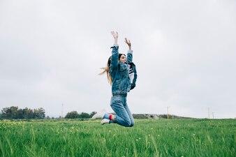Young female having fun in field