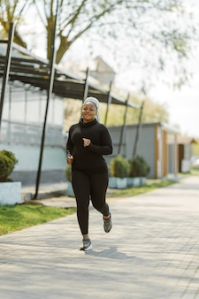 Young female having fun training outdoor. sporty people lifestyle concept. woman in sportswear jogging