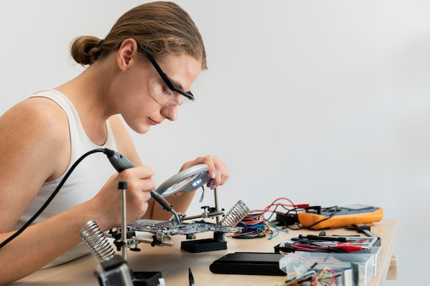 Young female inventor creating in her workshop