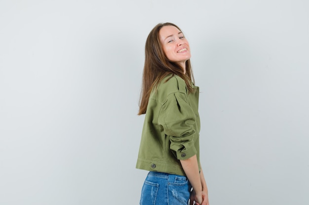 Young female in jacket, shorts and looking dizzy. .