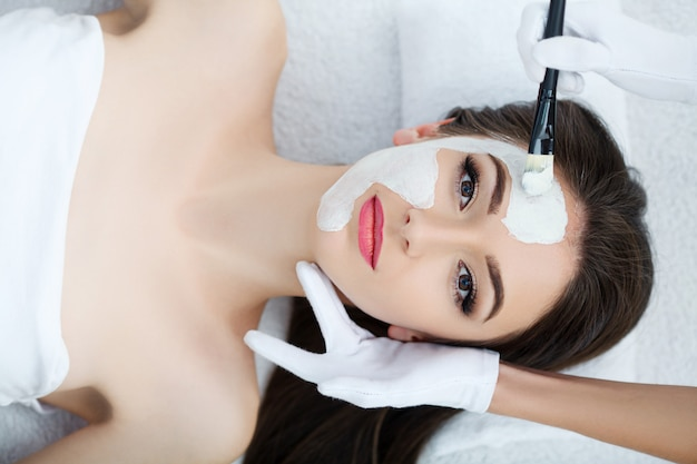 Young female lying in spa salon after procedure of body massage