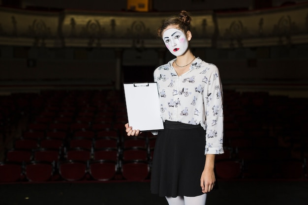 Young female mime holding manuscript