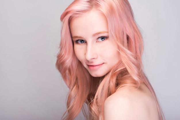Young female model staring over shoulder