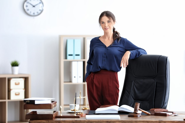 Young female notary in office