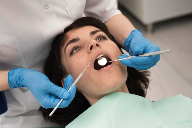 Young female patient having dental procedure at the orthodontist