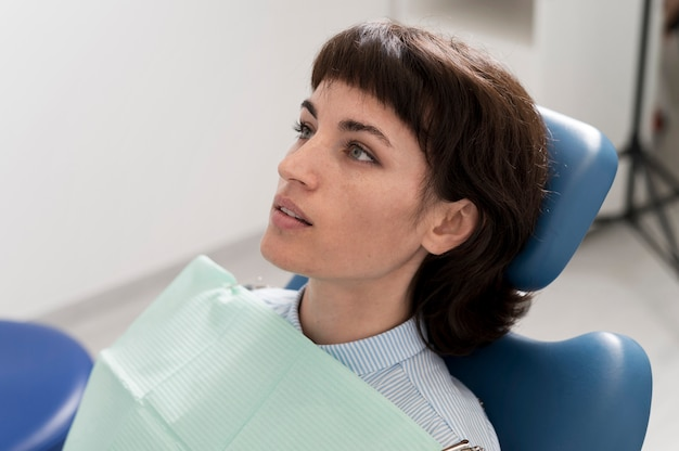 Young female patient waiting to have dental procedure at the dentist