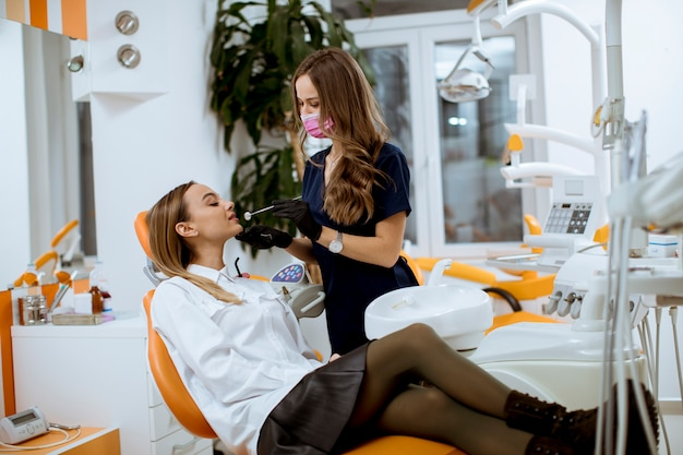Young female patinet at oral checkup at the dentist office