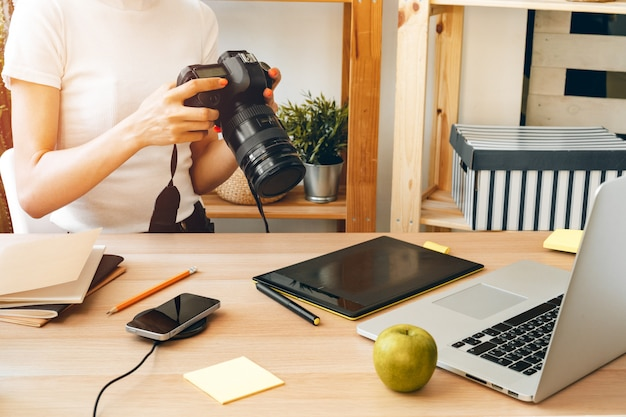 Young female photographer artist working at home office. stay at home.