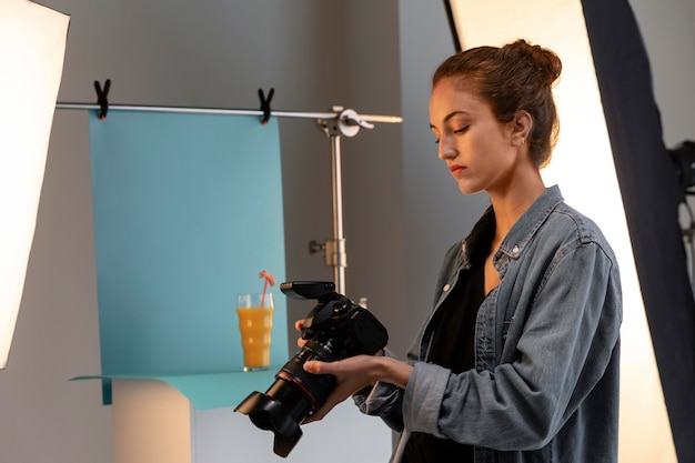 Young female product photographer in studio