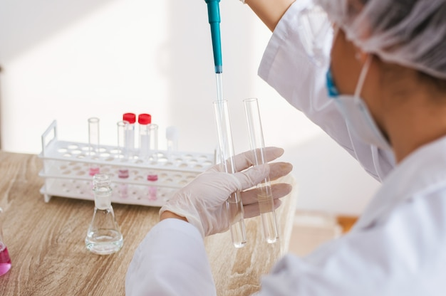 Young female scientist making experiments in laboratory