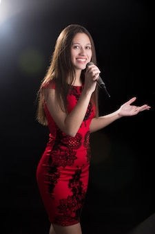 Young female speaker in red dress