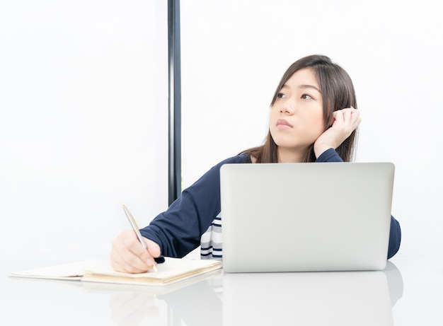 Young female student  sitting in living room and learning online