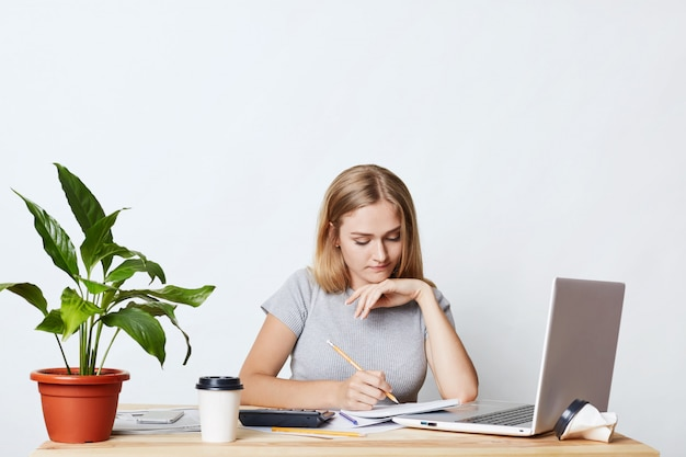 Young female student studying