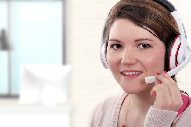 Young female support phone operator in headset