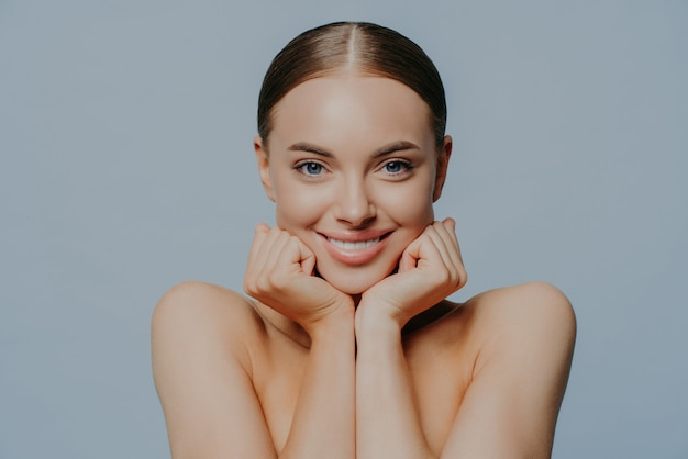 Young female takes care of skin and body health