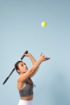 Young female tennis player with racket