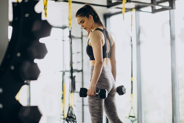 Young female trainer exercising at the gym
