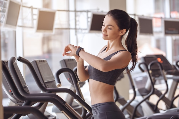 Young female training in gym healthy lifestyle elliptical trainer