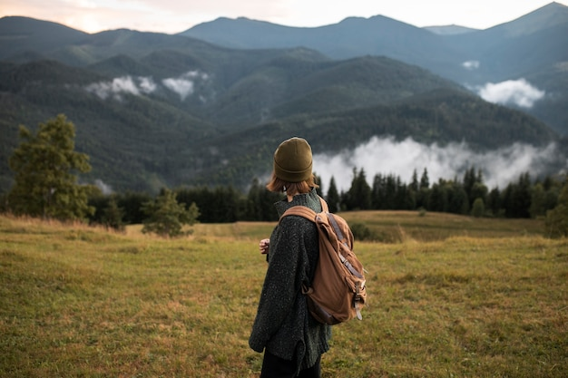 Young female traveler enjoying rural surroundings