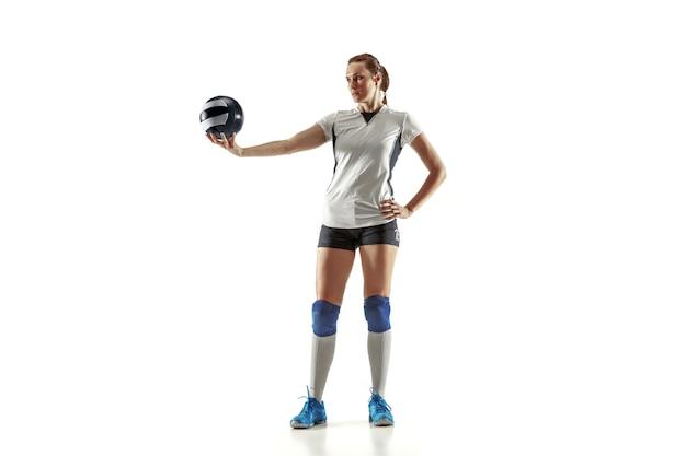 白い背景で隔離の若い女性バレーボール選手。