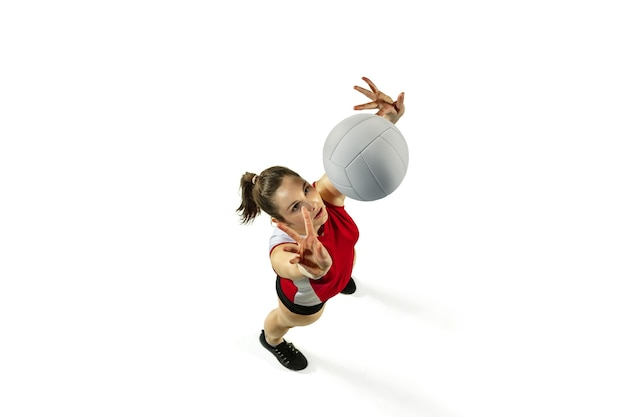 Young female volleyball player isolated on white  background.