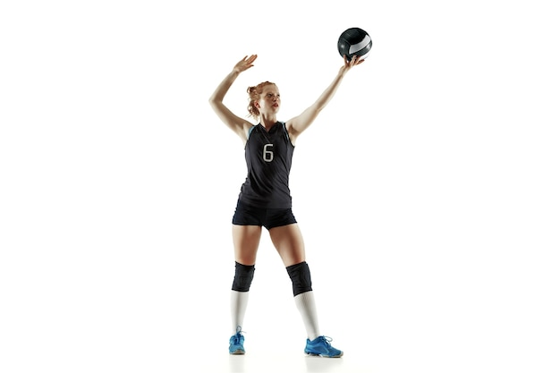 Young female volleyball player isolated on white studio background