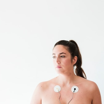 Youngfemale with electrodes on body