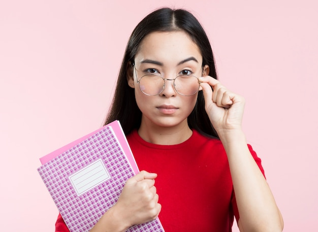 Young female with glasses and book