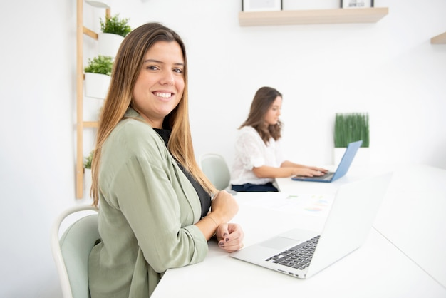 Young female workers in their office during their working hours