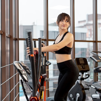 Young female working on treadmill