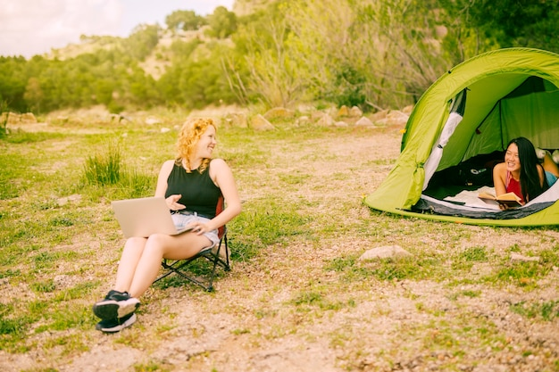 Young females camping in forest