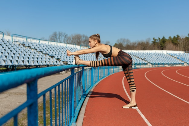 Young fit beautiful girl stretching