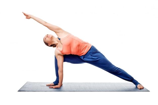 Young fit woman doing ashtanga vinyasa yoga asana