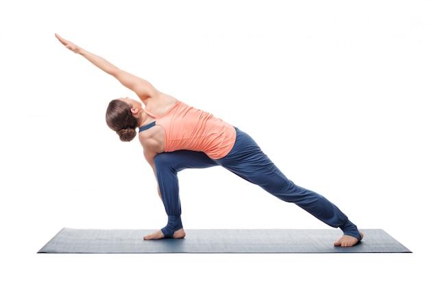 Young fit woman doing ashtanga vinyasa yoga