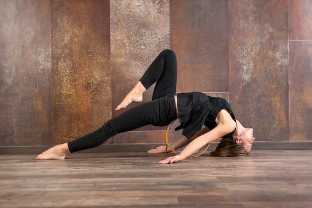 Young fit woman doing matsyasana yoga pose