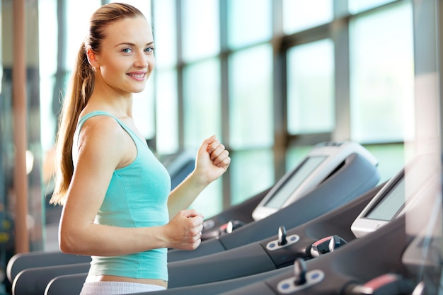 Young fit woman at gym jogging