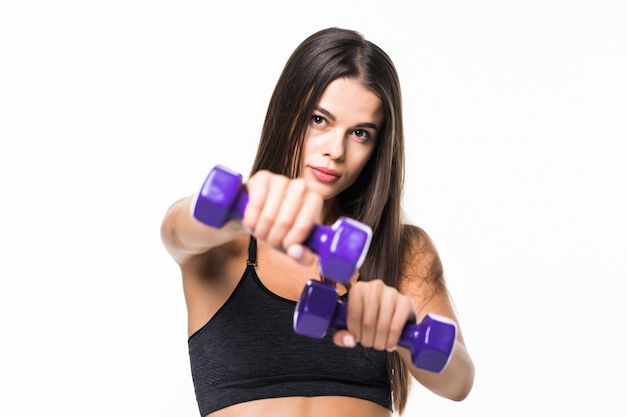 Young fit woman lifting dumbbells isolated on white
