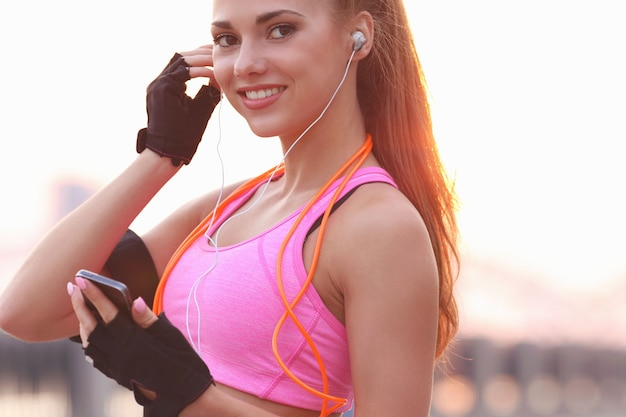 Young fit woman in sportswear outdoors