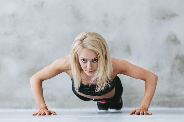 Young fit woman in sportswear training