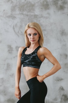 Young fit woman in sportswear