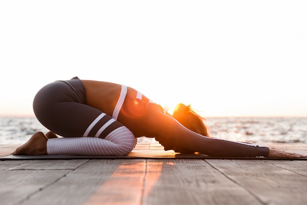 Young fitness lady stretching