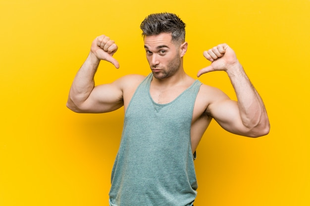 Young fitness man feels proud and self confident, example to follow.
