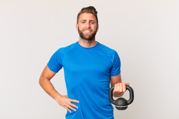 Young fitness man lifting a dumbbell