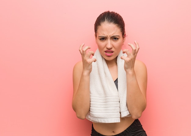 Young fitness woman angry and upset