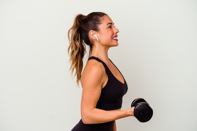Young fitness woman with dumbbells isolated on white background