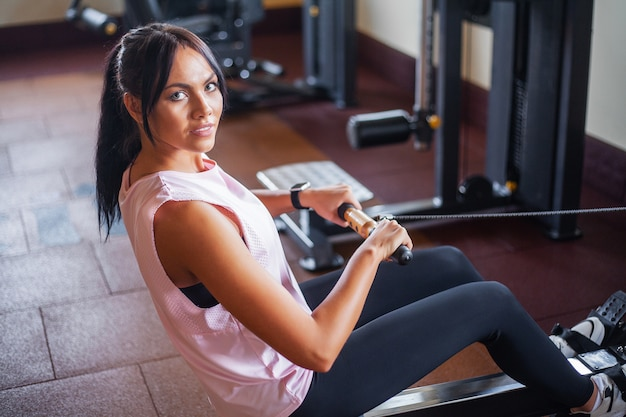 Young fitness woman working out in the gym
