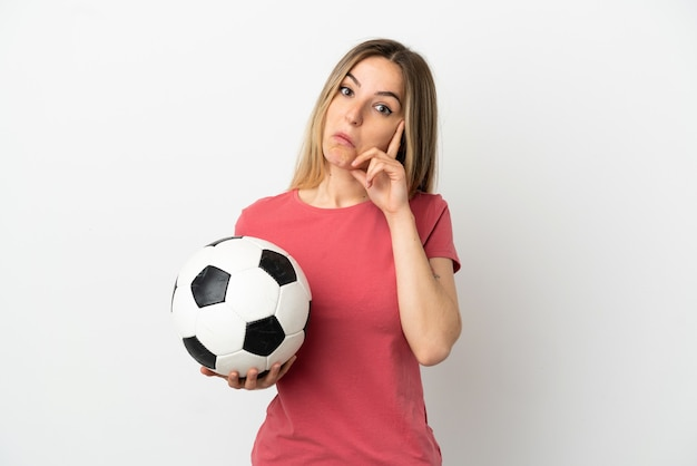 Young football player woman over isolated white wall thinking an idea