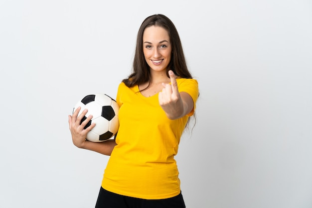 Young football player woman isolated