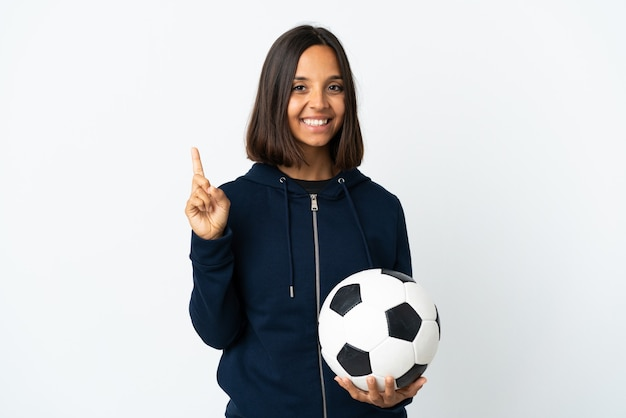 Young football player woman on white showing and lifting a finger in sign of the best