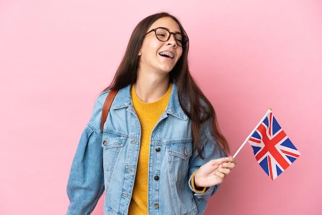 Молодая французская девушка с флагом соединенного королевства изолирована от смеха